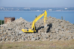 Excavator on the construction of a bridge in Kerch Stock Photos