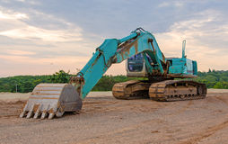 Excavator construction equipment park at worksite Royalty Free Stock Photo