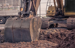 Excavator construction equipment park at worksite Royalty Free Stock Photography