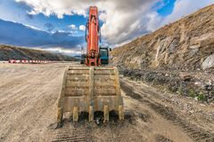 Excavator in the construction of a highway royalty free stock images