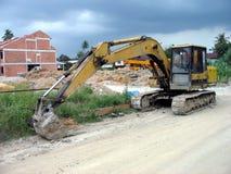 Excavator at construction site. Caterpillar excavator with a bucket at a construction site Royalty Free Stock Photo