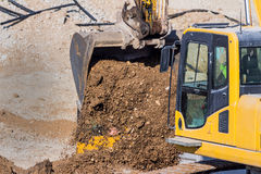 Excavator on construction site with earthworks Stock Images