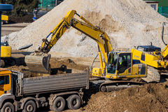 Excavator at construction site during excavation Royalty Free Stock Photos