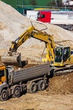 Excavator at construction site during excavation Stock Photo