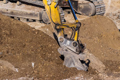 Excavator at construction site during excavation Royalty Free Stock Image