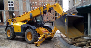 Excavator on the construction site stock images