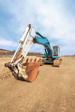 Excavator on construction site. Excavator on road construction site. Wide angle view Stock Images