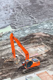 Excavator on a construction site Stock Images