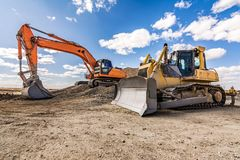 Excavator in a construction site on a sunny day stock image