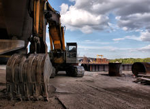Excavator on the construction site to build a new bridge. Royalty Free Stock Image