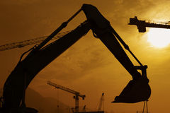 Excavator in construction site. Under sunset Royalty Free Stock Photos