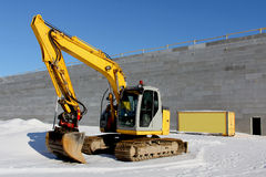 Excavator on a Construction Site in Winter Stock Images