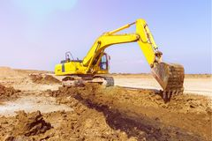 Excavator in construction site royalty free stock photos
