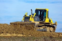 Excavator at construction work on site. An excavator on a construction site during construction work. Excavation and dredging Royalty Free Stock Photography