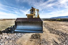 Excavator on the construction works of a highway stock photos