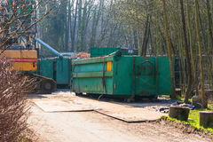 Excavator and container on a construction site. stock photography
