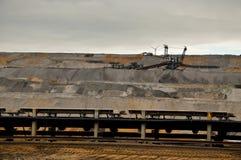 Excavator and conveyor belt Stock Photos