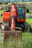 Excavator in countryside Stock Image