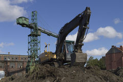 Excavator and crane at the shipyard in Gdansk Royalty Free Stock Photo