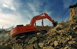 Excavator crushing rocks Stock Photos