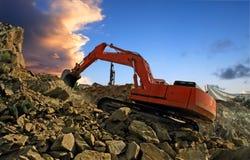 Excavator crushing rocks Stock Images