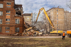 Excavator demolishes old school building Royalty Free Stock Photos