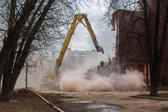 Excavator demolishes old school building Royalty Free Stock Image