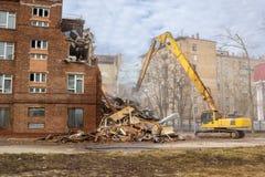 Excavator demolishes old school building Stock Photography