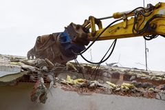 Excavator for demolishing Royalty Free Stock Photos