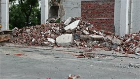 Excavator demolishing concrete & brick rubble debris. Excavator demolishing concrete and brick rubble debris stock footage