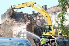 Excavator. An excavator demolishing a damaged building Royalty Free Stock Images