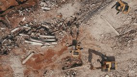 Excavators demolishing old factory for new construction project, aerial top view. Excavator demolishing house, aerial top view stock video