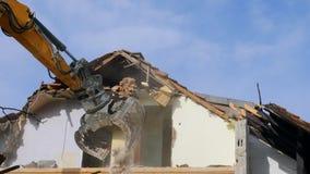 Excavator demolishing a house. Bavaria, Germany, Europe stock video footage