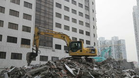 Excavator demolishing a house. In the city of Shanghai, China stock video footage
