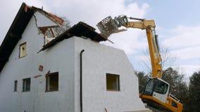 Excavator demolishing a house. Bavaria, Germany, Europe stock video