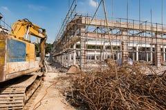 Excavator demolishing old building Stock Images