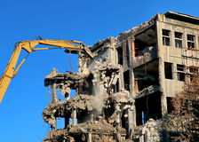 Excavator for demolition. Building demolition with hydraulic excavator Stock Images