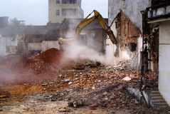 Excavator demolition houses china Stock Photography