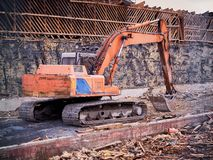 Excavator at demolition site breaking down the building.  Royalty Free Stock Image