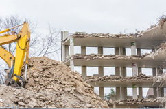 Excavator in demolition work Stock Image