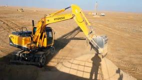 Excavator in the desert stock footage