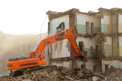 Excavator destroys old house. Royalty Free Stock Images