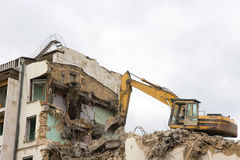 Excavator and destruction Stock Photos