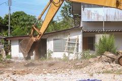 Excavator destruction in Work outdoor construction. Bucket Excavator. excavator destruction in Work outdoor  construction  that dust motion : select focus front Stock Photos