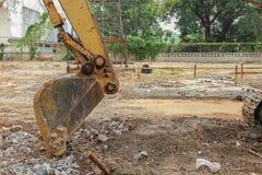 Excavator destruction in Work outdoor construction. Excavator working. excavator destruction in Work outdoor construction : select focus front bucket Excavator Stock Photo