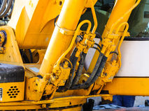 Excavator detail oil pressure hoses Stock Photos