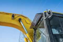 Excavator details. Top view of a Excavator with power tower on a blue sky Royalty Free Stock Images