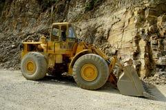 An excavator - digger. An digger vehicle at work Stock Image