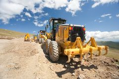 Excavator, digger, earthmover at construction site. Excavators and construction machinery at a construction site outdoors Stock Photography