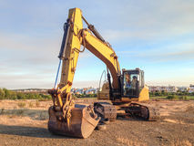 Excavator digger parked on a building site Royalty Free Stock Photography